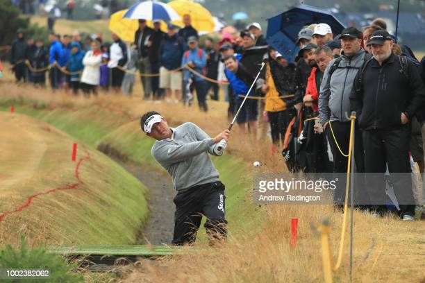 Shota Akiyoshi of Japan plays a shot from the rough on the ninth hole during the second round of the 147th Open Championship at Carnoustie Golf Club...