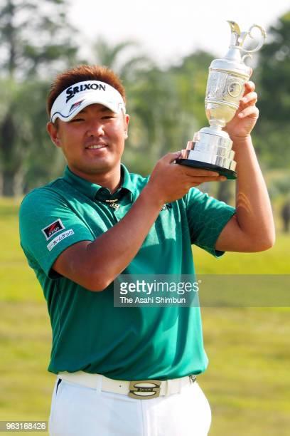 Shota Akiyoshi of Japan poses with the trophy after winning the Mizuno Open at the Royal Golf Club on May 27 2018 in Hokota Ibaraki Japan