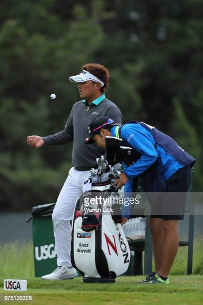 Shota Akiyoshi talks with his caddie on the sixth green during the second round of the 2018 US Open at Shinnecock Hills Golf Club on June 15 2018 in...