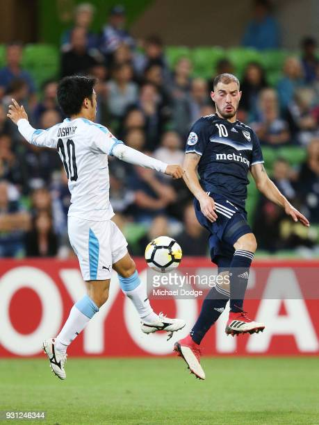 Shota Arai of Kawasaki Frontale and James Troisi of the Victory compete for the ball during the AFC Asian Champions League match between the...