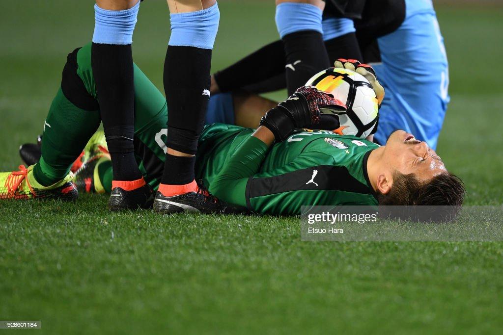 Shota Arai of Kawasaki Frontale lies injured during the AFC Champions League Group F match between Kawasaki Frontale and Melbourne Victory at Todoroki Stadium on March 7, 2018 in Kawasaki, Kanagawa, Japan.