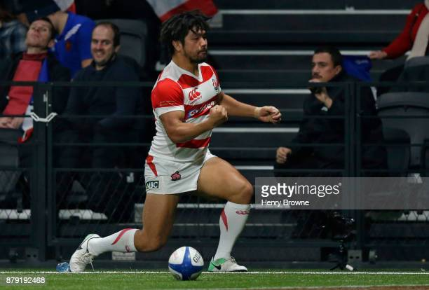 Shota Horie of Japan celebrates after scoring a try during the international rugby union match between France and Japan at U Arena on November 25,...