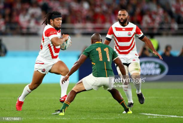 Shota Horie of Japan goes into contact with Makazole Mapimpi of South Africa during the Rugby World Cup 2019 Quarter Final match between Japan and...