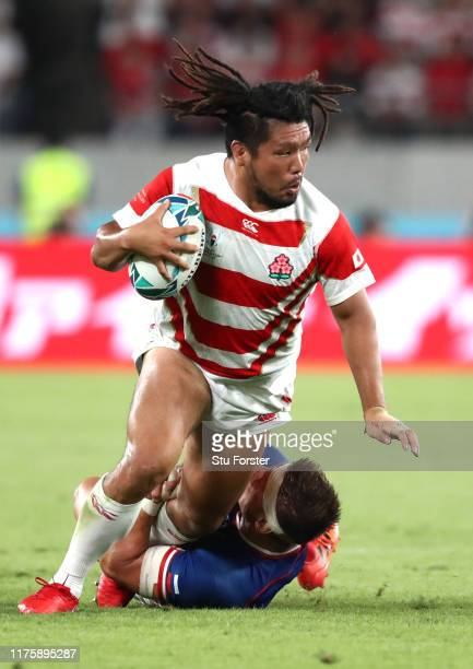 Shota Horie of Japan is tackled by Dmitry Gerasimov of Russia during the Rugby World Cup 2019 Group A game between Japan and Russia at the Tokyo...