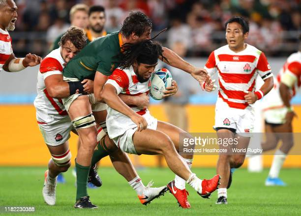 Shota Horie of Japan is tackled by Eben Etzebeth of South Africa during the Rugby World Cup 2019 Quarter Final match between Japan and South Africa...
