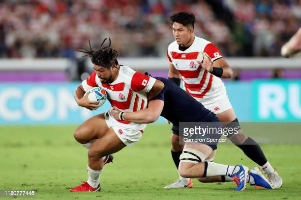 Shota Horie of Japan is tackled by Magnus Bradbury of Scotland during the Rugby World Cup 2019 Group A game between Japan and Scotland at...