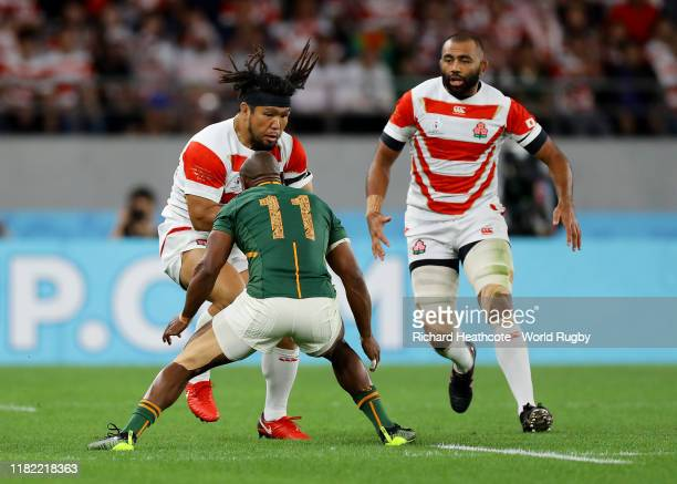 Shota Horie of Japan is tackled by Makazole Mapimpi of South Africa during the Rugby World Cup 2019 Quarter Final match between Japan and South...
