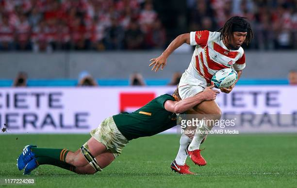Shota Horie of Japan is tackled by Pieter Steph du Toit of South Africa during the Rugby World Cup 2019 Quarter Final match between Japan and South...