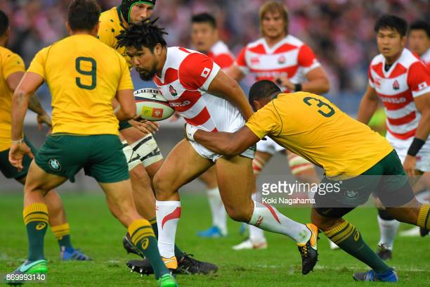 Shota Horie of Japan is tackled during the international match between Japan and Australia at Nissan Stadium on November 4, 2017 in Yokohama,...