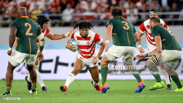 Shota Horie of Japan runs with the ball during the Rugby World Cup 2019 Quarter Final match between Japan and South Africa at the Tokyo Stadium on...