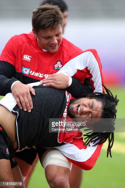 Shota Horie of Japan stretches with Pieter Labuschagne of Japan during a 2019 Rugby World Cup Japan team training session at Chichibunomiya Rugby...