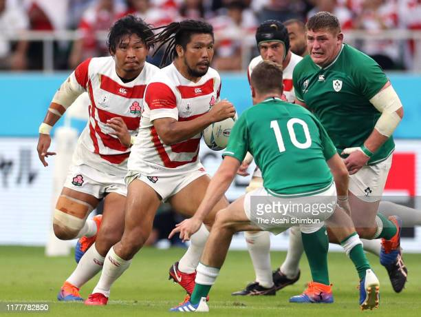 Shota Horie of Japan takes on Jack Carty of Ireland during the Rugby World Cup 2019 Group A game between Japan and Ireland at Shizuoka Stadium Ecopa...