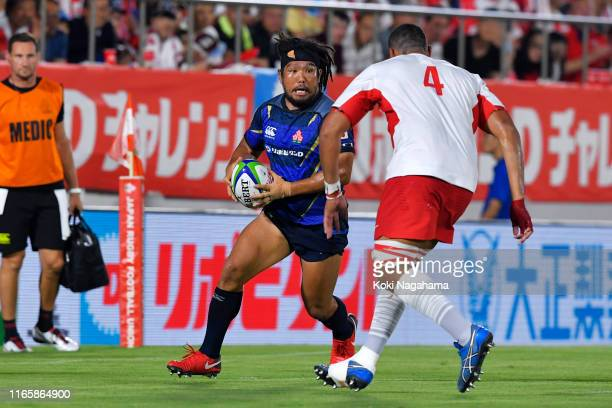Shota Horie of Japan takes on Sitiveni Mafi of Tonga during the Pacific Nations Cup match between Japan and Tonga at Hanazono Rugby Staidum on August...