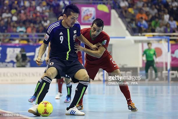 Shota Hoshi of Japan fends off Paulinho of Portugal during the FIFA Futsal  World Cup Group bf4a4de0d9415