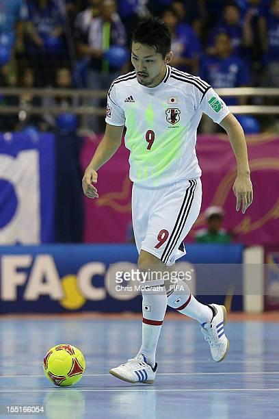 Shota Hoshi of Japan makes a break against Brazil during the FIFA Futsal  World Cup Group d04b9a54af533