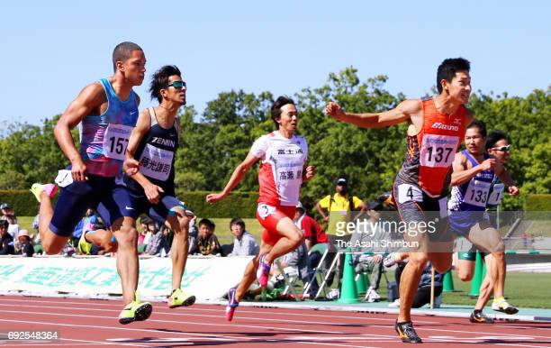 Shota Iizuka crosses the finish line to win in the Men's 100m final during the Fuse Sprint at CocaCola West Sports Park on June 4 2017 in Tottori...