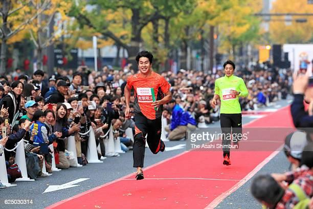 Shota Iizuka runs during the Midosuji Runway on November 20 2016 in Osaka Japan