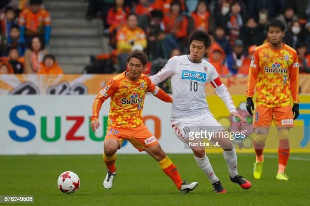 Shota Kaneko of Shimizu SPulse and Hiroki Miyazawa of Consadole Sapporo compete for the ball during the JLeague J1 match between Shimizu SPulse and...