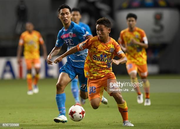 Shota Kaneko of Shimizu SPulse and Riki Harakawa of Sagan Tosu compete for the ball during the JLeague J1 match between Sagan Tosu and Shimizu SPulse...