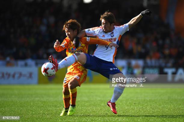 Shota Kaneko of Shimizu SPulse and Ryohei Yamazaki of Albirex Niigata compete for the ball during the JLeague J1 match between Shimizu SPulse and...