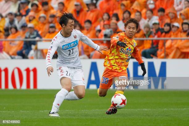 Shota Kaneko of Shimizu SPulse and Takuma Arano of Consadole Sapporo compete for the ball during the JLeague J1 match between Shimizu SPulse and...