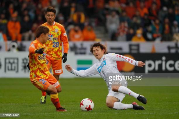 Shota Kaneko of Shimizu SPulse is tackled by Shingo Hyodo of Consadole Sapporo during the JLeague J1 match between Shimizu SPulse and Consadole...