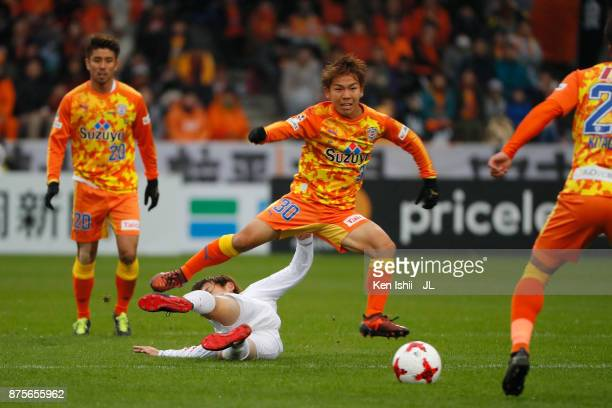 Shota Kaneko of Shimizu SPulse is tackled during the JLeague J1 match between Shimizu SPulse and Consadole Sapporo at IAI Stadium Nihondaira on...