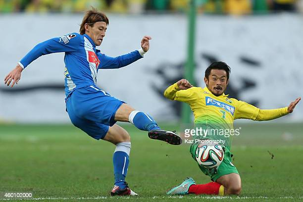 Shota Kawanishi of Montedio Yamagata and Yuto Sato of JEF United Chiba compete for the ball during the J1 Promotion PlayOff Final match between JEF...