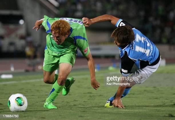 Shota Kobayashi of Shona Bellmare and Tomohiko Miyazaki of Jubilo Iwata compete for the ball during the J.League match between Shonan Bellmare and...