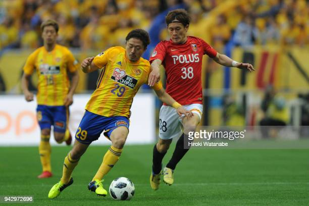 Shota Kobayashi of Vegalta Sendai and Daisuke Kikuchi compete for the ball during the J.League J1 match between Urawa Red Diamonds and Vegalta Sendai...