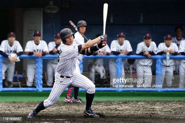 Shota Morishita of SAMURAI JAPAN hits a homer in the bottom half of the seventh inning during the practice match between Collegiate Japan and...