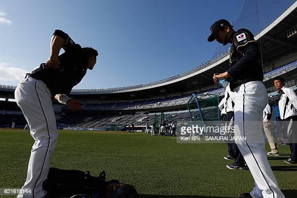 Shota Ohno and Ayumu Ishikawa of Samurai Japan prepare during the Japan national baseball team practice session at the QVC on November 7 2016 in...
