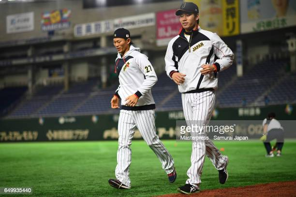 Shota Ohno and Shota Takeda of Japan in action during the practice day during the World Baseball Classic at Tokyo Dome on March 9 2017 in Tokyo Japan