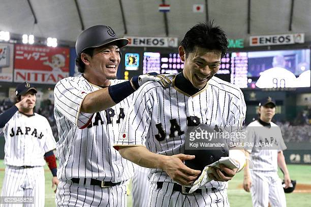 Shota Ohno celebrates with teammates after hitting a RBI in the tenth inning during the international friendly match between Japan and Netherlands at...