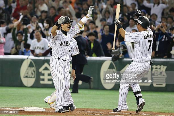 Shota Ohno of Japan celebrates after hitting a RBI in the tenth inning during the international friendly match between Japan and Netherlands at the...