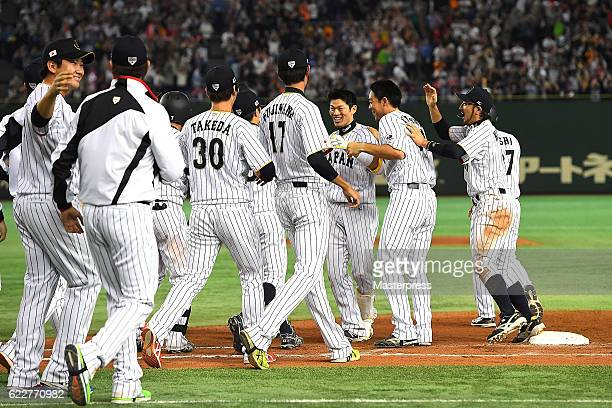 Shota Ohno of Japan celebrates with his teammates after hitting a RBI in the tenth inning to win during the international friendly match between...