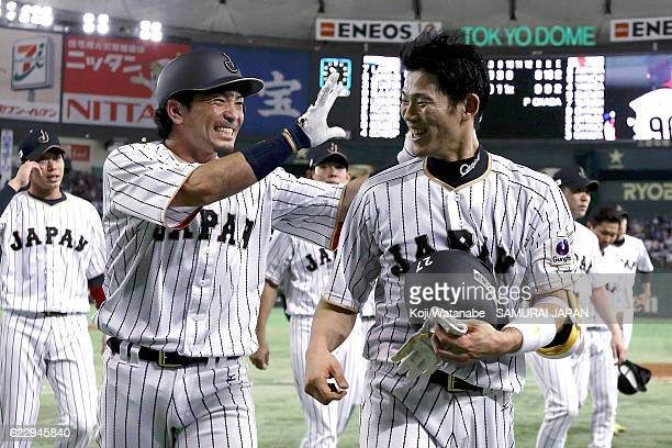Shota Ohno of Japan celebrates with teammates after hitting a RBI in the tenth inning during the international friendly match between Japan and...