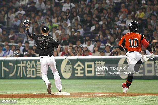 Shota Ohno of Japan touches the base with a ball during the international friendly match between Netherlands and Japan at the Tokyo Dome on November...