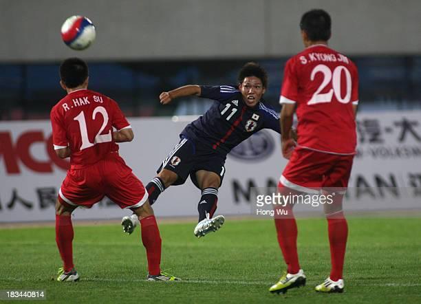 Shota Sakaki of Japan shoots during the 6th East Asian Games Men's Football match between Japan and North Korea at Tianjin Haihe Education Park...