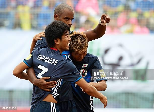 Shotaro Haraguchi of Japan celebrates scoring with his teammates Ozu Moreira and Takasuke Goto during the Continental Beach Soccer Tournament match...
