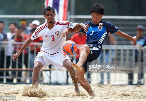 Shotaro Haraguchi of Japan competes for the ball with Ahmed Beshr of United Arab Emirates during day five of the AFC Beach Soccer Championship 2017...