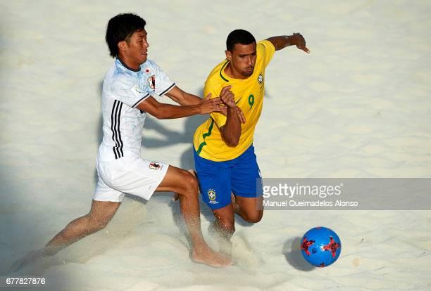 Shotaro Haraguchi of Japan competes for the ball with Rodrigo da Costa of Brazil during the FIFA Beach Soccer World Cup Bahamas 2017 group D match...