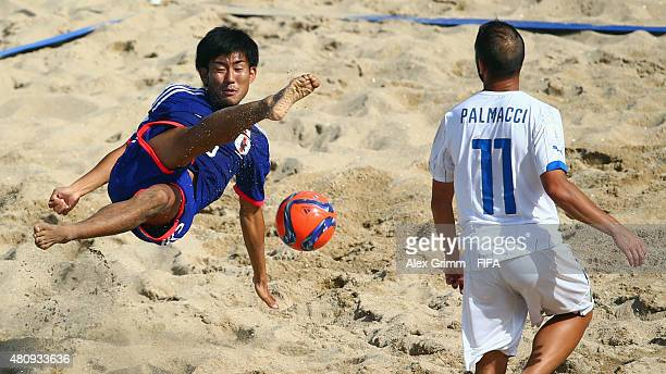 Shotaro Haraguchi of Japan does a bicycle kick next to Paolo Palmacci of Italy during the FIFA Beach Soccer World Cup Portugal 2015 Quarterfinal...