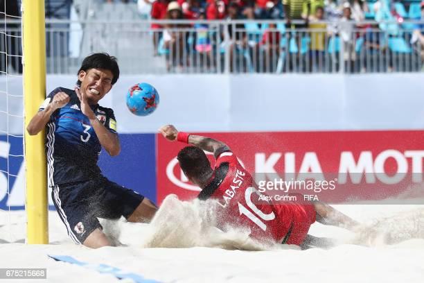 Shotaro Haraguchi of Japan is challenged by Tearii Labaste of Tahiti during the FIFA Beach Soccer World Cup Bahamas 2017 group D match between Tahiti...