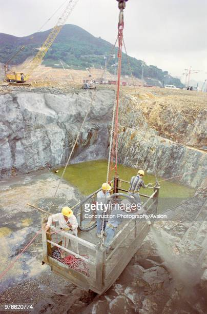 Shotcreting the face of a steep rock excavation for a tunnel approach on a new line for the Hong Kong MTR system