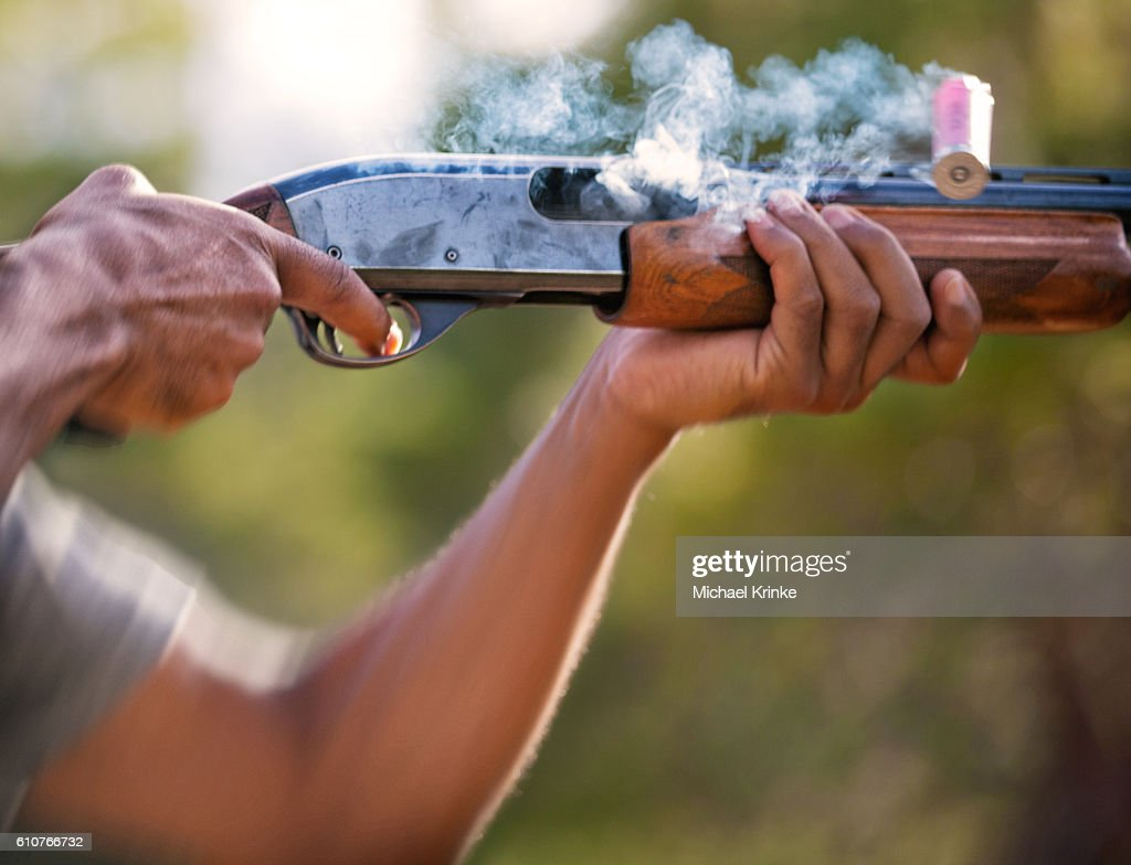 Shotgun fired and shell expelled : Stock Photo