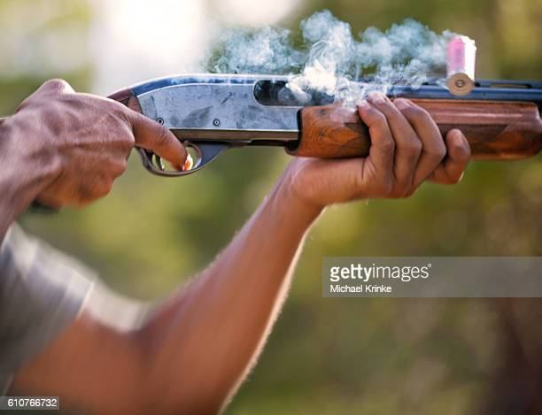 shotgun fired and shell expelled - taking a shot sport stock pictures, royalty-free photos & images