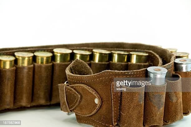 shotgun shells and used cartridge belt ... close-up - leather belt stock pictures, royalty-free photos & images
