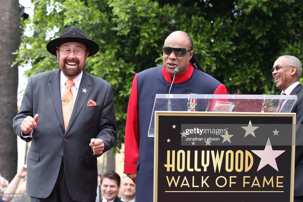 'Shotgun Tom' Kelly and Stevie Wonder attend the ceremony honoring 'Shotgun Tom' Kelly with a star on The Hollywood Walk of Fame held on April 30, 2013 in Hollywood, California.