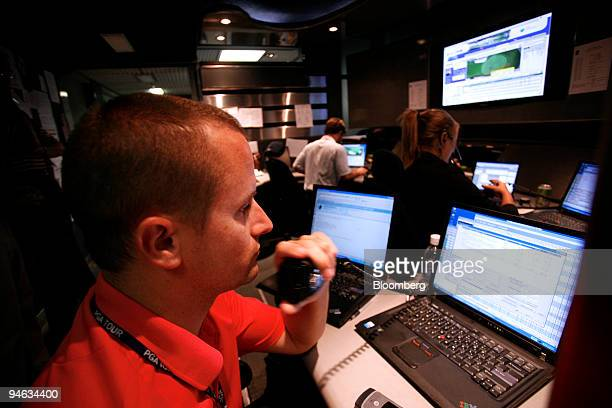 """SHOTLink producer monitors data sent in by """"walking scorers"""" via radio during the Barclays Classic golf tournament at Westchester Country Club in..."""
